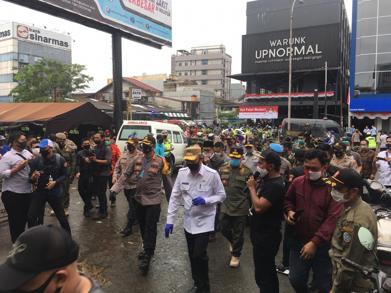 Tempatkan Banyak Petugas di Pasar Tertibkan Masyarakat Pakai Masker 1