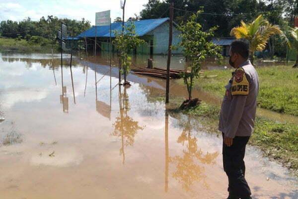 Polres Melawi Kontrol Debit Air: Antisipasi Banjir Dadakan