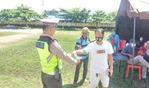 Satgas Operasi Patuh Polres Melawi Pantau Vaksinasi dan Bagikan Masker